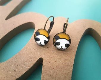 Earrings cabochon yellow background glass and panda