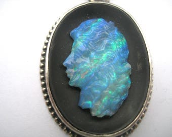 Silver Pendant with women Cup of Opal on black background