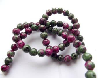 62 irregular coloured zoisite ruby 6 mm