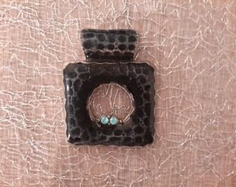 faux snake skin metal pendant