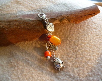 Ladybird charm bag charm is blessed and orange beads
