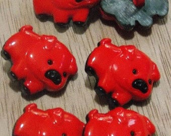 Set of six buttons with red pig foot