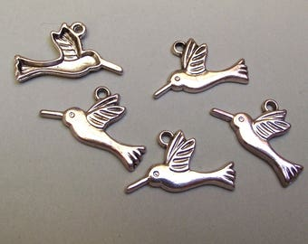 10 silver colored metal Hummingbird charms.
