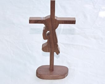Cross on a stand - Boy Praying