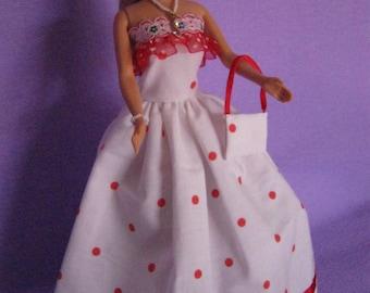 Long white dress has red dots (B162)