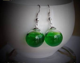 Transparent Spring Green liquid filled glass globe mounted on silver plated