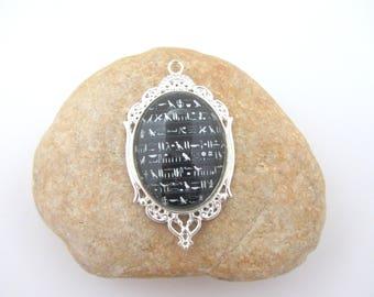 A pendant with cabochon glass hieroglyphics