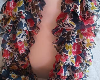 Ruffle scarf in floral motif on blue background fabric
