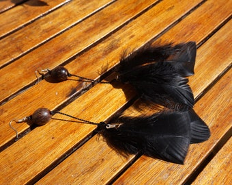 Earrings black feathers and seeds of Palm tree
