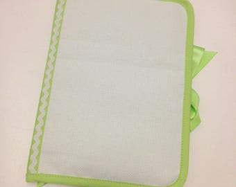 Health book has cross-stitch, lime green 100% cotton fabric, choose outline