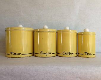 Mid-century yellow kitchen canisters