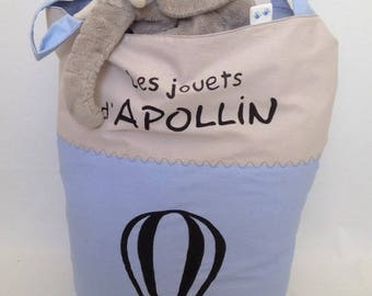 Beige and blue toys with handles bag