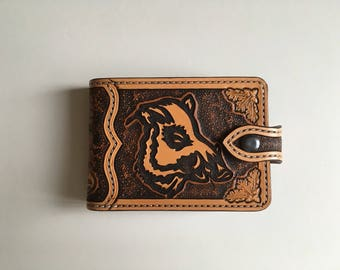 Portfolio style ticket and coin pattern tooled leather wallet: wild boar and duck carved
