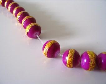 4 round pearls fushia gold plated
