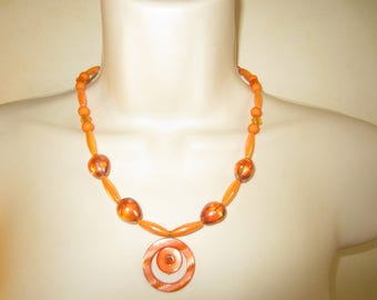 Orange necklace with mother of Pearl pendant