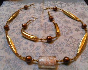 set (necklace and bracelet) fine, classy, dressy (gold and copper)