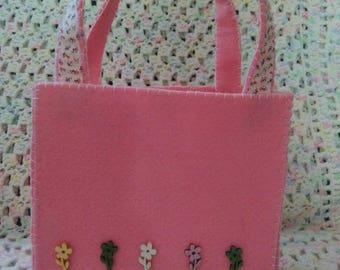 Pink felt pouch.