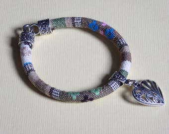 khaki and beige ethnic bracelet and heart pendant