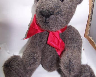 Red bow with Brown plush teddy bear