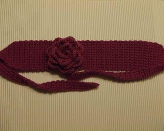 Purple headband adorned with a pink crochet