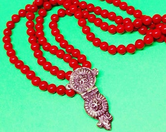 Necklace with floral pendant