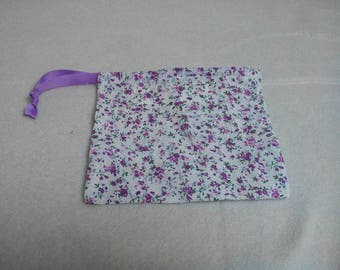 White pouch fabric purple flower motifs