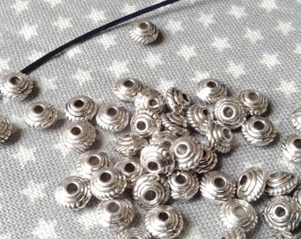 Set of 50 beads, silver, 5 x 3 MM find 1.5 MM.