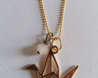 Crane origami with her Pearl Necklace