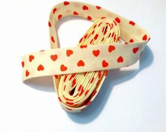 1 m bias cotton, ecru, red hearts pattern