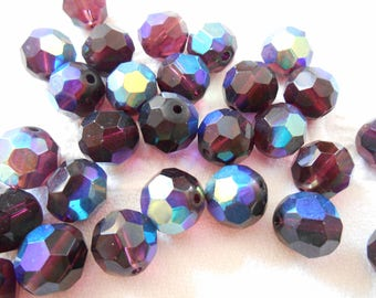 A set of six beads Bohemian glass faceted purple AB.
