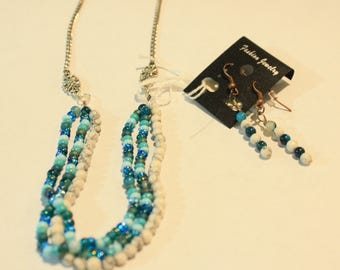 Multistrand beaded necklace and matching earrings