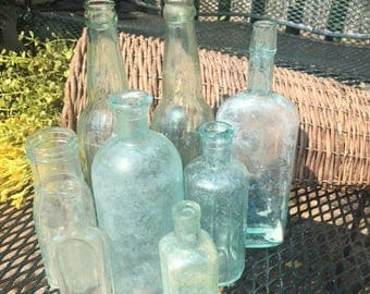 Set of 7 vintage green glass bottles