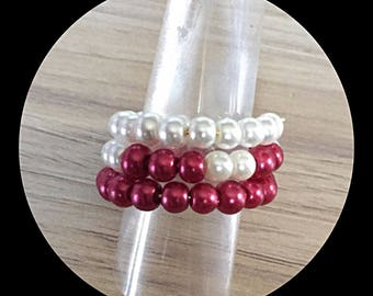 Ring triple strand memory wire and glass beads.