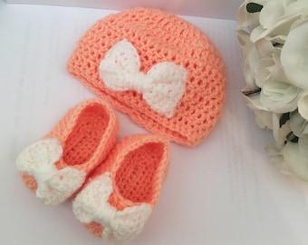 Handmade crochet baby hat and booties set