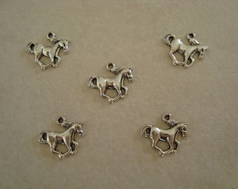 Silver metal galloping horse charm