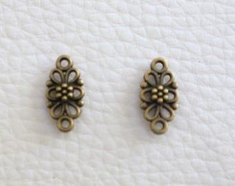 2 bronze flower connectors