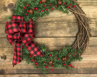 RUSTIC CHRISTMAS WREATH. Grapevine wreath, buffalo plaid bow, pine bough, red berries, rustic jingle bells, trendy