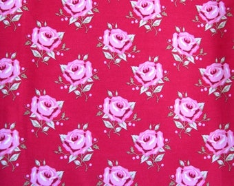 90 cm of Tilda fabric 100% cotton patterned with pink flowers on red background