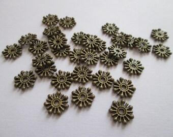 30 perles étoile flocon en métal bronze diamètre 10mm