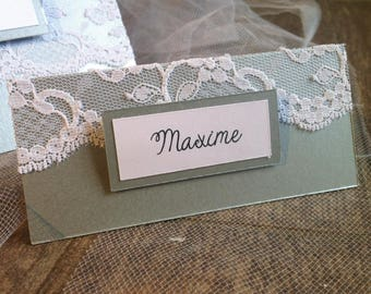 Silver place cards and lace