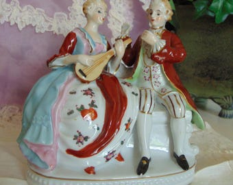 Antique figurine Couple with Instrument