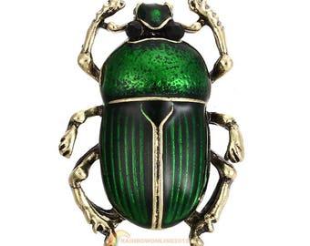 Broche scarabée doré et émaux vert.