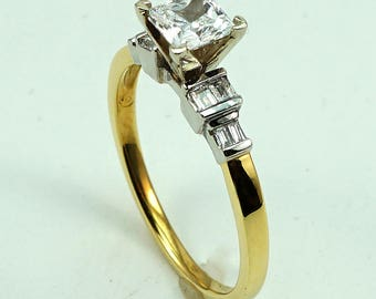 Engagement Ring 18K YG CZ Center Stone with 8-Diam Side Stones at 0.17 Cts.