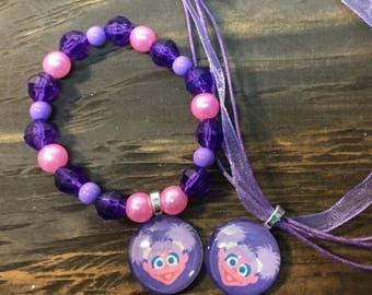 Abby cadabby party favors.Abby Cadabby bead bracelet.Abby Cadabby pendant necklace.Abby Cadabby birthday party.Sesame street party favors