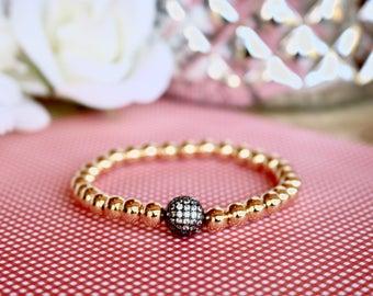 Gold Skinny with dark embellished rhinestone bead