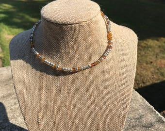 silver and iridescent amber