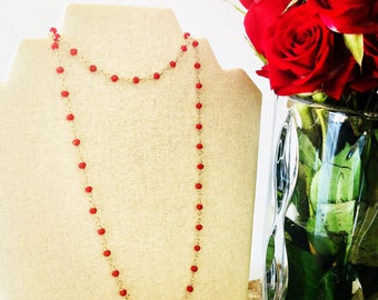 Gold chain with red Swarovski crystal beads