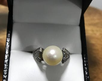 Diamond, platinum and pearl ring, circa 1930