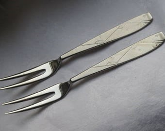 Vintage pair of inox pickle forks. Stainless steel and made by Sola Zeist Holland. Dutch science fiction futuristic design 1960s