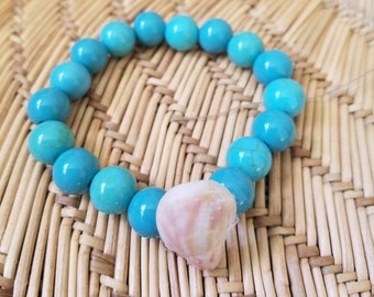 Stretch Bracelet made with a Beached Shell and Turquoise Colored Beads